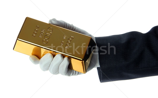 hand with glove holding a gold bullion Stock photo © pterwort