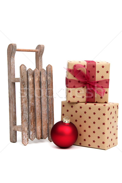 old wooden sledge with christmas presents on white Stock photo © pterwort
