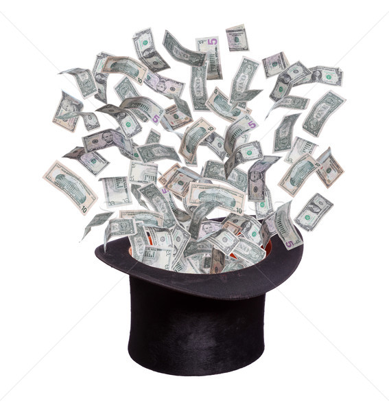 dollars flaying out of old hat Stock photo © pterwort