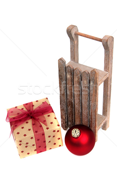 old wooden sledge with present on white Stock photo © pterwort