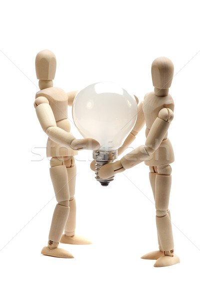 two dolls holding a light bulb Stock photo © pterwort