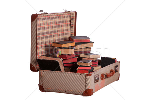 very old suitcase stuffed with old books Stock photo © pterwort
