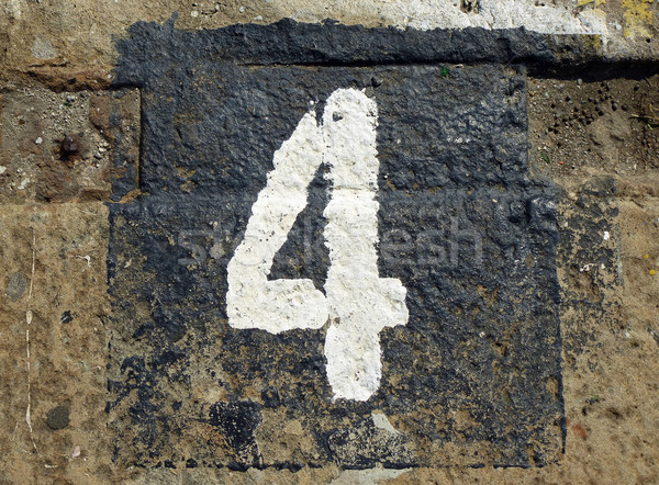 4 - weathered number on old stone Stock photo © pterwort