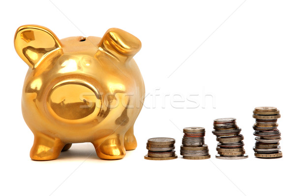 golden piggy bank and stacks of coins Stock photo © pterwort