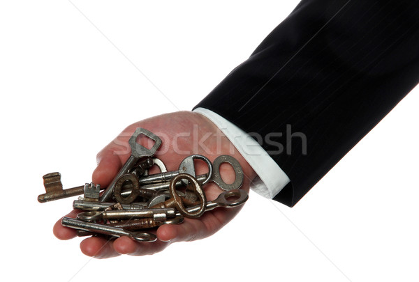 rusty keys on palm of hand Stock photo © pterwort