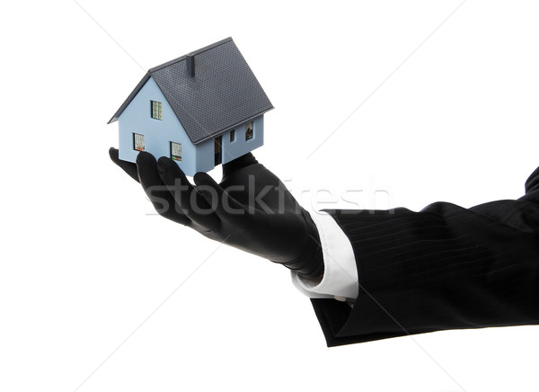 house offered by black rubber glove Stock photo © pterwort