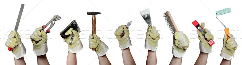 Stock photo: concept of tools in hands with gloves