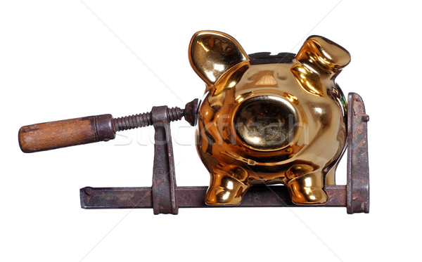 Stock photo: piggy bank under pressure in old clamp