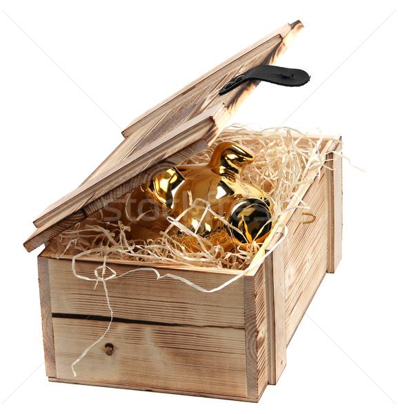 golden piggybank in box with wood-wool  Stock photo © pterwort