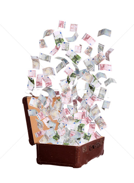 Stock photo: euros flying out of old suitcase