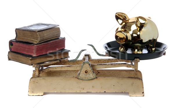 scale with books and golden piggy bank Stock photo © pterwort