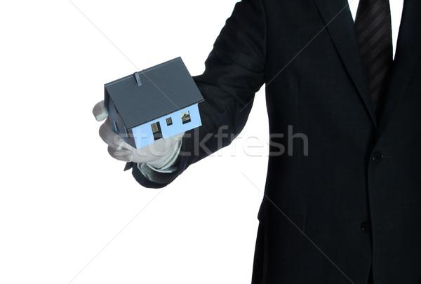 salesclerk with house in his hand Stock photo © pterwort