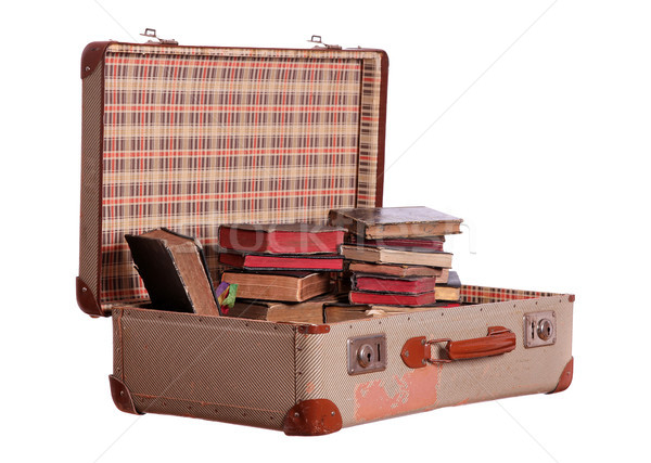 old suitcase stuffed with old books Stock photo © pterwort