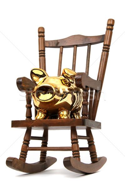 Velho cadeira de balanço dourado piggy bank branco Foto stock © pterwort