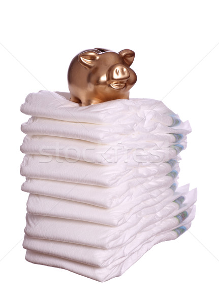 stack of diaper with golden piggybank Stock photo © pterwort