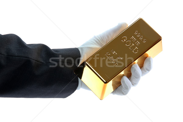 hand with glove holding a gold bar Stock photo © pterwort