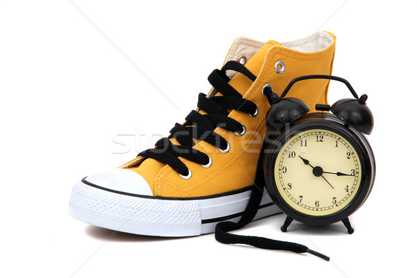 Sneaker with clock Stock photo © pterwort