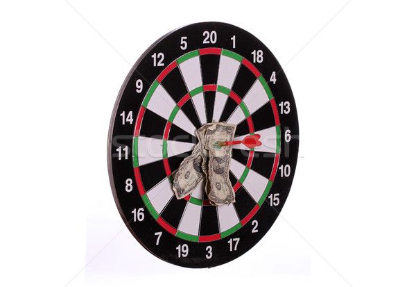 dard board with centered arrows and dollars Stock photo © pterwort