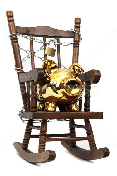 Oude houten schommelstoel spaarvarken keten hangslot Stockfoto © pterwort