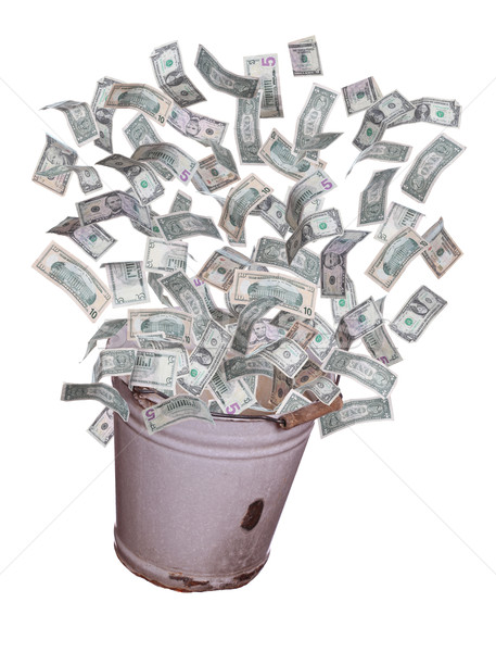 dollars flying out of old bucket Stock photo © pterwort