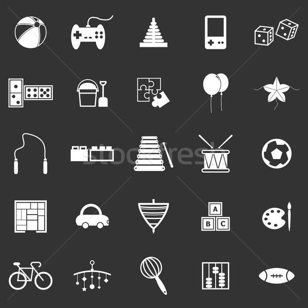 Toy icons on black background Stock photo © punsayaporn