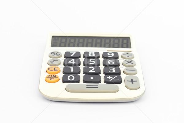 Calculator geïsoleerd witte voorraad foto werk Stockfoto © punsayaporn