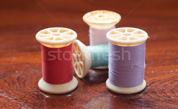 Vintage grunge colorful thread spool on wooden table Stock photo © punsayaporn