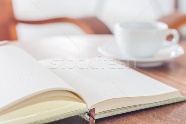 Blank notebook with coffee cup Stock photo © punsayaporn