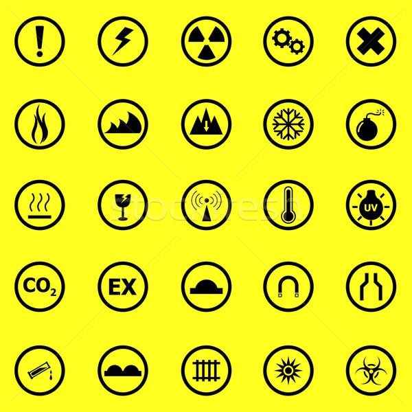 Warning sign icons on yellow background Stock photo © punsayaporn