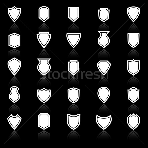 Shield icons with reflect on black background Stock photo © punsayaporn