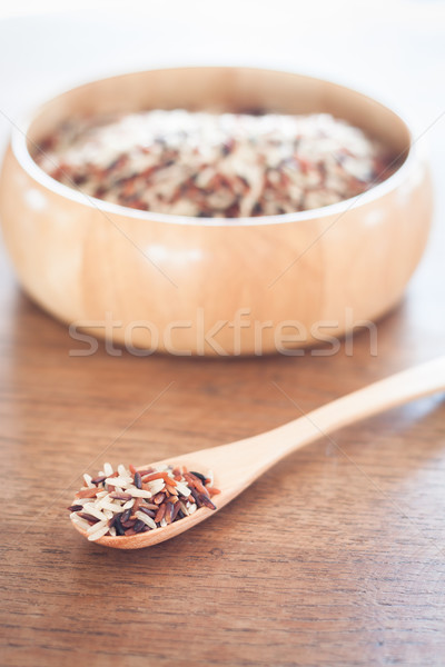Organic Dry Multi Grain Rice in wooden bowl Stock photo © punsayaporn