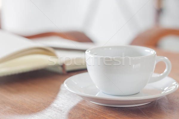 Stock photo: White coffee cup with notebook