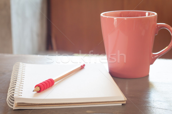 Blank notebook with pencil on grey background Stock photo © punsayaporn