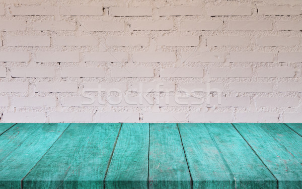 Stock photo: Blue wooden table top with white brick wall