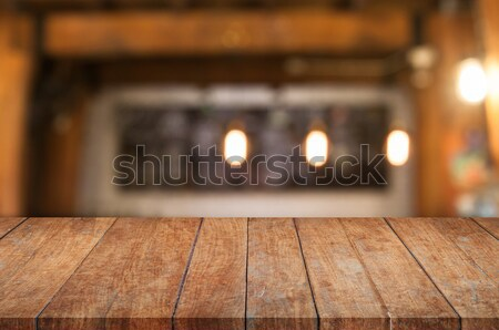Brown wooden table top with coffee shop Stock photo © punsayaporn