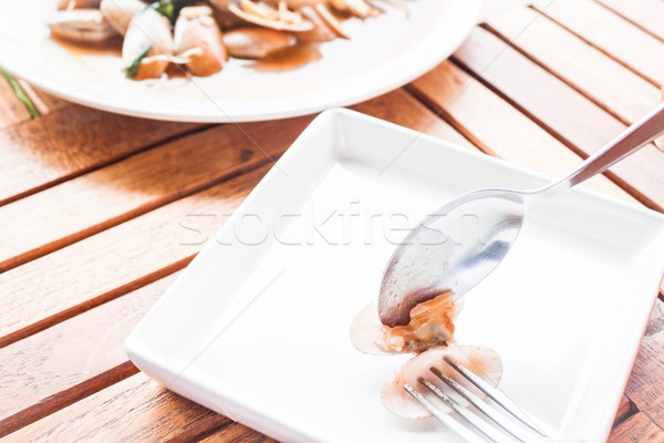 Spoon and fork on stir fried clams with roasted chili paste  Stock photo © punsayaporn
