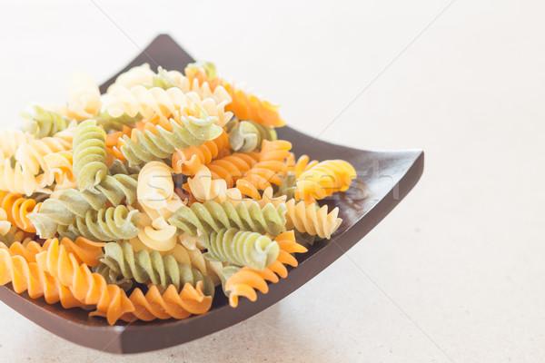 Raw fusilli pasta on wooden tray Stock photo © punsayaporn