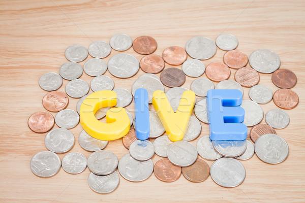 Give alphabet with various US coins Stock photo © punsayaporn