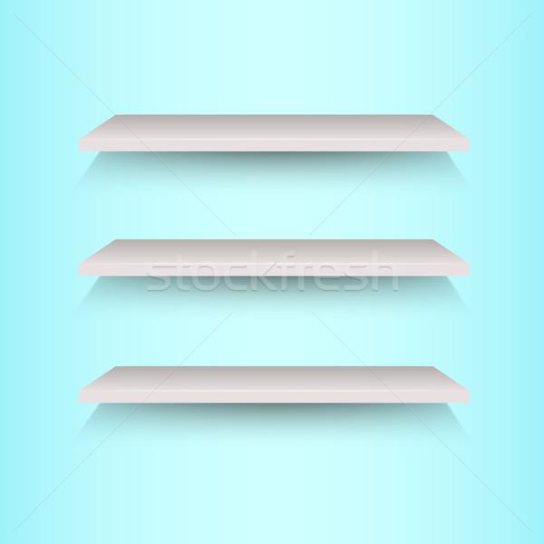 Book shelves on blue background Stock photo © punsayaporn