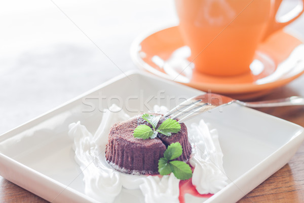 Chocolate lava with orange coffee cup Stock photo © punsayaporn