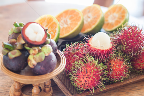 Thai tropical fruit on wooden table Stock photo © punsayaporn