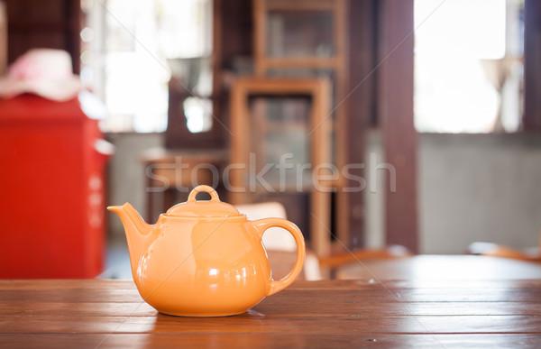 Tea pot on wooden table Stock photo © punsayaporn