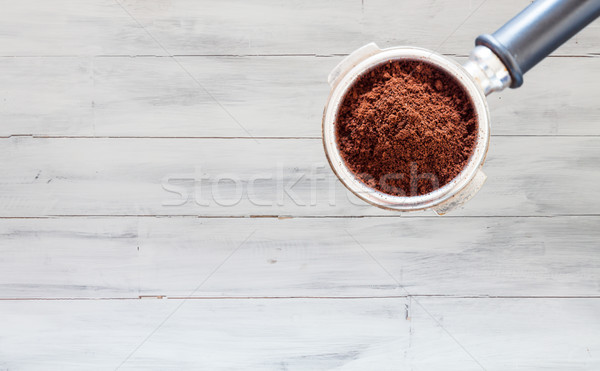 Coffee grind in group on white wooden background Stock photo © punsayaporn