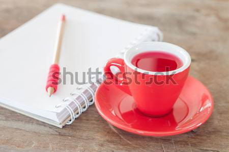 Red mug with open notebook Stock photo © punsayaporn
