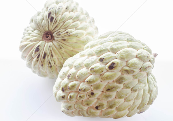 Couple unripe custard apple isolated on white background Stock photo © punsayaporn