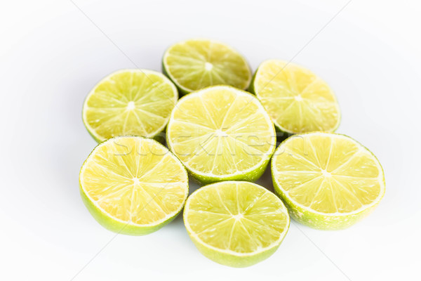 Half portion citrus lime slice on white background Stock photo © punsayaporn