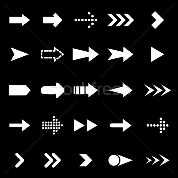 Arrow icons on black background Stock photo © punsayaporn