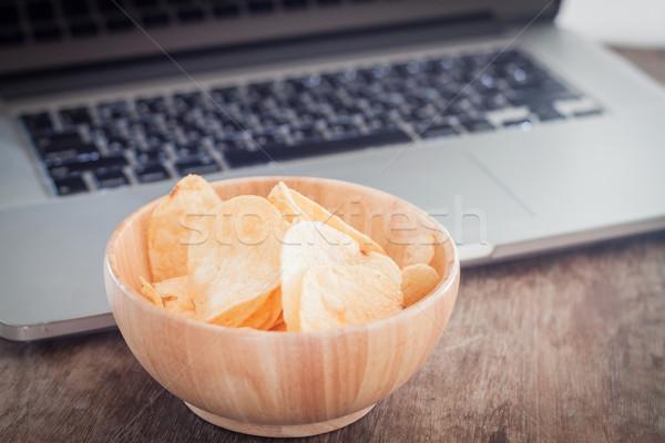 Crispy potato chips on wotk station Stock photo © punsayaporn