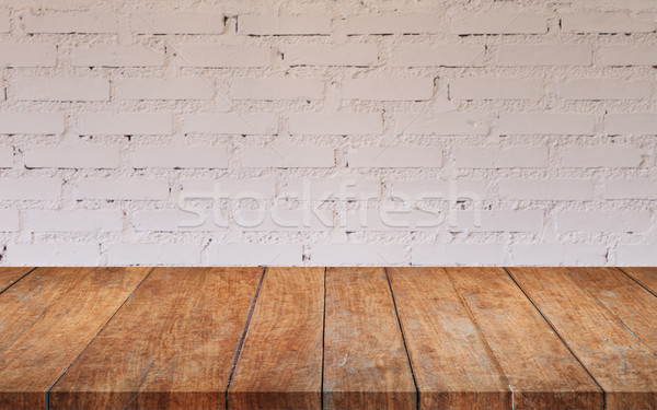 Stock photo: Brown wooden table top with white brick wall