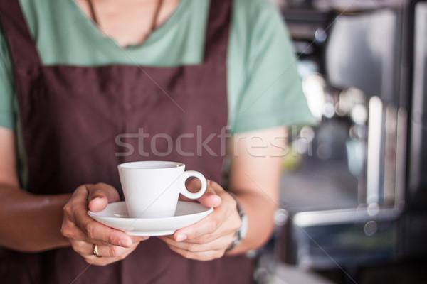 Asian barista serving freshly brewed coffee  Stock photo © punsayaporn